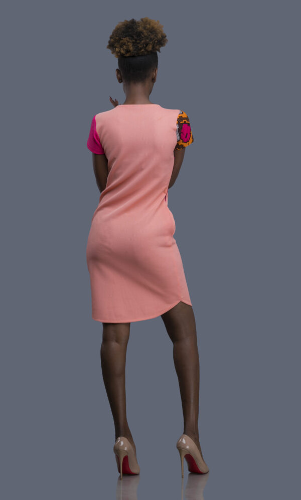 Back of GIGI Shift Tee Dress in Peach with pink sleeve and African print detail